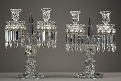 A pair of Baccarat crystal two lights girandoles ornate with cut glass pendeloques...