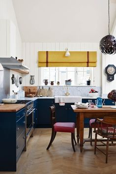 Moving from a tall house to a west-London mews enabled interior designer Caroline Riddell to enjoy a more open-plan way of living. traditional and contemporary pieces work together, where a mix match of chairs around the dining table create an informal dining look - Kitchen Design Ideas (houseandgarden.co.uk)