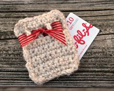 Crochet Gift Card Holder from One Artsy Mama. I've done two of these so far and it is so simple! Colors can be changed for any occasion! Awesome original idea!