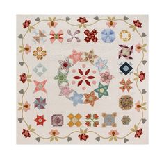 I think this will have to be added to my project list! A combination of English paper piecing and needleturn applique