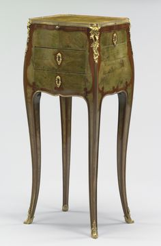 Table -- Adrien Faizelot-Delorme (French, died after 1783, active 1748 - 1783, master 1748) -- Paris, France; about 1760 -- Veneered with amaranth and green stained burr yew on oak carcass; gilt bronze mounts -- 68.9 x 29.5 x 24.4 cm (27 1/8 x 11 5/8 x 9 5/8 in.)