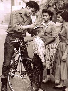ELVIS PRESLEY & young fans on the Paramount back lot during the filming of Loving You(1957) from The Blue Jean by Alice Harris 2002. (please follow minkshmink on pinterest) #elvis #elvispresley #theking #bicycle #elvisfans #fifties #jeans