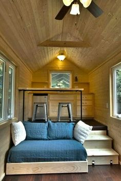 Great Open Layout Where Bed Rolls Away Under Kitchen During the Day | via Tiny Home Builders