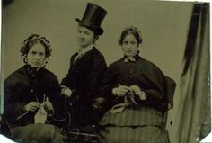 ca. 1870-1900, [tintype portrait of three women, two knitting, one dressed in a suit and top hat holding yarn]