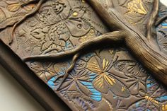 Another beautiful journal. Cover sculpted in polymer clay.