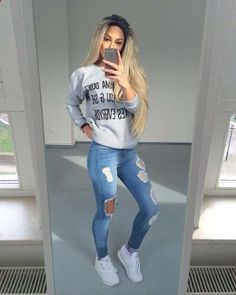 Casual cozy cute fall outfit ideas that anyone can wear teen girls or women. The ultimate fall fashion guide for high school or college. Comfy outfit with ripped jeans, sneakers and a gray sweater. #teenfashionoutfits #schooloutfits #womensfashioncasualfall