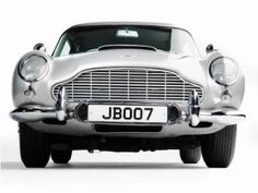 """Like Sean Connery, the weaponized Aston Martin of """"Goldfinger"""" fame is as handsome as ever. Read on to learn more on the 1965 Aston Martin brought to you by the automotive experts at Motor Trend. James Bond Auto, James Bond Movies, Aston Martin Db5, Next Mens Shoes, Vintage Cars, Antique Cars, Automobile, Bond Girls, Dream Cars"""