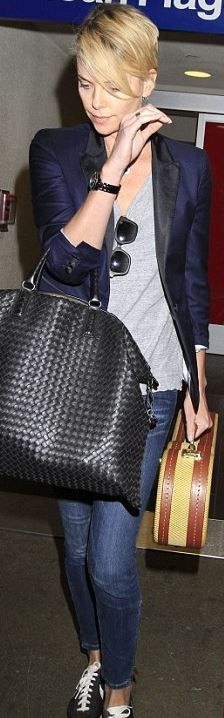 Who made Charlize Theron's black watch, woven handbag, and sneakers that she wore at LAX airport?