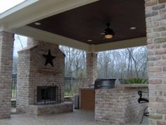 i think i need a red brick (to match the house) fireplace on the deck - and I need the dark tongue and groove wood ceiling and lights as well - my columns can be white tho - not loving the brick pillars