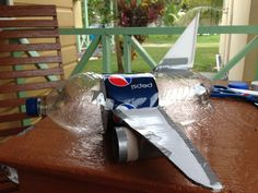 Airplane made from: Pepsi plastic bottle (body), cardboard box (wings), styrofoam (tail), toilet paper rolls (engine), and duct tape to hold everything together
