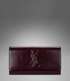 Large YSL Clutch in Dark Magenta Patent Leather at http://www.ysl.com/en_US/product/804871335