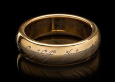 ThinkGeek :: Gold-Plated Tungsten Carbide One Ring $99.99