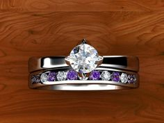 I like how they sit flush together, and the channeled wedding band. The engagement ring shape is just a little odd.