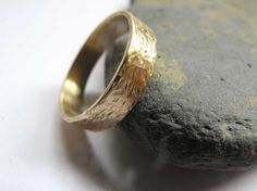 Mens hammered gold band ring.  This 9ct yellow gold band ring is handmade in my London studio. It is 5mm wide and made from 1mm thick sheet