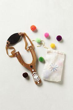 toy slingshot. love the pom poms for shooting.