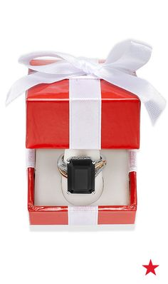 This onyx and diamond ring is a sure way to surprise her on Christmas morning.