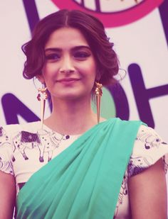 I feel like this is Sonam Kapoor. Looks exactly like my cousin O_O. Love the ensemble + colors