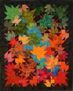 "New Leaves Wallhanging. Approx. 39.5 X 49""  NEW LEAVES from the designer of THIRD WEEKEND IN OCTOBER because so many of you have asked for a wallhanging version of that wonderful scrap quilt!  Unique setting - no repeated blocks. Partially paper pieced."