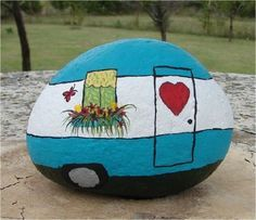 10 Ideas How To Paint Rocks To Decorate Your Home - This rock is painted to be a camper.