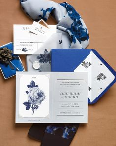 """When Louis Vuitton, Rochas, and Valentino are showing bloom-adorned frocks, this pattern is anything but old-fashioned. Little Cat Design Co.'s """"Mod Flower"""" suite consists of a botanical-enlivened invite, R.S.V.P. postcard, and wallet reminder. Vellum wrapping, fastened with a self-adhesive wax seal, holds the elements together. Have Little Cat print it (price upon request), or opt for a digital file and do it yourself to save some ducats."""