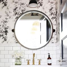 Roses + subway tile = perfection in this bathroom from interior designer @studiomcgee.  We love how our Kensington Mirror was used in the space as the perfect foil to the wallpaper.  Bravo! #bathrooms #whitebathrooms #subwaytile