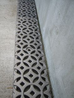 An unexpectedly lovely detail, the decorative drain grate by Iron Age Design is truly eye-catching. The cast metal grates offer intricate design for Drainage Grates, Tree Grate, Plumbing Drains, Stone Landscaping, Paved Patio, Floor Drains, Basement Flooring, Dream House Exterior, Iron Age