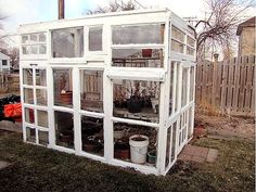 DIY greenhouse made from old window frames.  Have to make this when we move North!  All we need is a house and we're off...can't wait