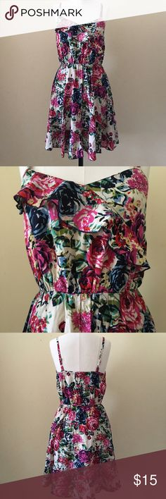 """Bright and breezy floral dress Pretty floral dress with ruffle across bust and ruffled hem. Super bright and gorgeous floral/rose print. Adjustable straps. 35"""" shoulder to hem, 12"""" waist measured flat (stretches to 17"""" flat). Cotton/Rayon. Perfect condition. ModCloth Dresses"""