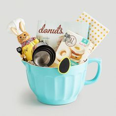 "Fill our big, bright mixing bowl with festive notions to create a custom Easter gift ""basket"" for your favorite baker. Our handpicked assortment of goodies includes a book on donuts, donut mix, chalkboard egg clips, bunny-themed kitchen towels and a bunny nutcracker. >> #WorldMarket Spring, Easter Baskets"