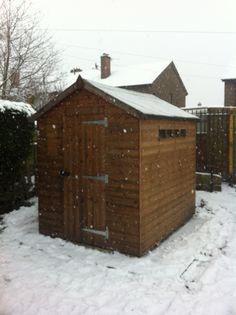 8 x 6 Apex Security Timber Garden Shed installed in the snow.