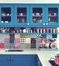 This is awesome! Much better then any boring monotone backsplash I have ever seen.