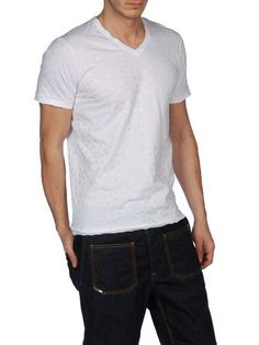 Diesel & EDUN - white jersey v-neck t-shirt with a faint spot/dogon pattern. £90. Made in Africa.