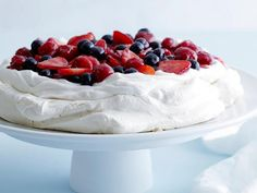 Mixed Berry Pavlova : This crisp-on-the-outside, gooey-on-the-inside cloud of meringue is topped with sweetened whipped cream and fresh berries. This showstopping recipe is sure to become a family favorite.