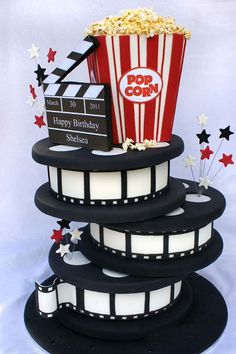 Film cake with clapperboard and popcorn.
