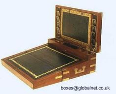 A double opening  or triple writing box of c1810 made in the traditional campaign style of solid mahogany with brass straps corners and countersunk handles. The upper part has pockets in gold embossed leather and a central section which folds down to reveal a pocket for letters.