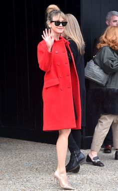 Renée Zellweger from Stars at Paris Fashion Week Fall 2015  The actress looks positively delightful in a poppy-red coat outside of Miu Miu in Paris.