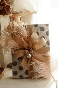 Polka dot gift wrap with feather adornment
