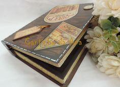 Caixa em MDF em formato de livro. Com pintura imitando couro, decoupage e apliques.