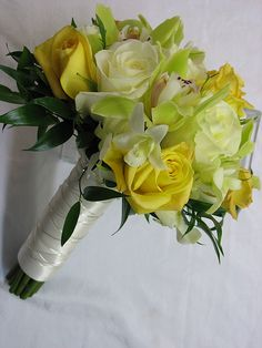 Yellow Roses, Ivory Roses, Green Cymbidium Orchids and White Dendrobium Orchids; Silver wire handle detail | Walden Floral Design
