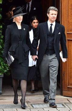 Sorrow: Crown Princess Mary and Crown Prince Frederik walk hand-in-hand as they leave the church