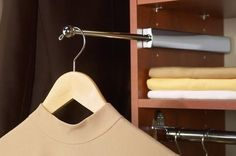 Install an extendable valet rod for extra hanger space. | 53 Seriously Life-Changing Clothing Organization Tips