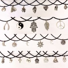 Silver tone charm on 20 inches of black waxed cord. To fasten, tie cord to your desired length.Image 1 (Left to Right)- Top row: 90s Smiley, Pizza, Mary Jane, Shell, Elephant, Fries, Shroom- Second row: Wishbone, Yin Yang, Large Hamsa, Feather, Peace- Third row: Starry Moon, Sun Face, Moon Face, Large Sun, Cut-Out Moon, Sun