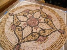 Image from http://www.mosaicartsupply.com/images/products/3-customer-art/mosaic-medallion-CL-3.jpg.