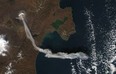 Shiveluch Volcano, on Russia's Kamchatka Peninsula, erupted on October 6, 2012, sending a plume of ash high into the air, carried first south, then east, as winds shifted. Shiveluch is one of the biggest and most active volcanoes on the Kamchatka Peninsula. (NASA/Jeff Schmaltz, LANCE MODIS Rapid Response Team)