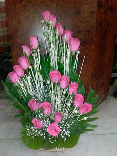 Gorgeous pink roses green leaves and baby's breath floral arrangement Tropical Floral Arrangements, Creative Flower Arrangements, Church Flower Arrangements, Beautiful Flower Arrangements, Altar Flowers, Church Flowers, Funeral Flowers, Flower Shop Decor, Flower Decorations