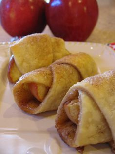 Bite Sized Apple Pies.... I love apples! 1 tube crescent roll dough 1/2 cup sugar 2 tsp. cinnamon 3 tbsp. melted butter, divided 2 medium tart apples, each cut into 8 wedges Directions: In a small bowl, combine the sugar and cinnamon, set aside 1 Tbsp. On a lightly floured surface, unroll the crescent dough. Brush with 2 Tbsp. melted butter, sprinkle with remaining sugar mixture.