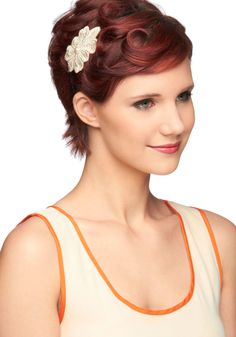 You've long sought out the perfect pearly accent to your casually elegant outfit. Finally, you found this darling headband and its ivory, embroidered, pearl-decorated accents. Its slender, black band and shimmering, flower-shaped embellishment give your violet shift, brogues, and gold pendant a pop of subtle sophistication. It's no wonder you fell for this ladylike look!