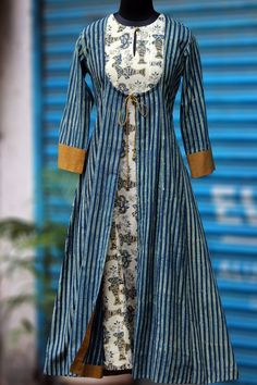 Buy Maati Crafts Blue Cotton Printed Front Cut Kurti online in India at best price.we bring you an eclectic mix of fish & the universe dress in ajrakh in contemporary mughal choga styling! Salwar Designs, Kurta Designs Women, Kurti Designs Party Wear, Dress Neck Designs, Designs For Dresses, Blouse Designs, Front Cut Kurti, Kalamkari Dresses, Kurta Neck Design
