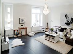 flagstone floor chaiselong Italian sofa lounge and kitchen on two levels ground floor Swedish rounded walls on two levels lower kitchen furniture Scandinavian Nordic style glass stairs decoration interior design interior Swedish shoe box with pink bedspread modern kitchen white kitchen