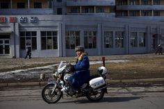 A North Korean traffic policeman on a motorcycle patrols a street in central Pyongyang, North Korea on Friday, February 22, 2013.